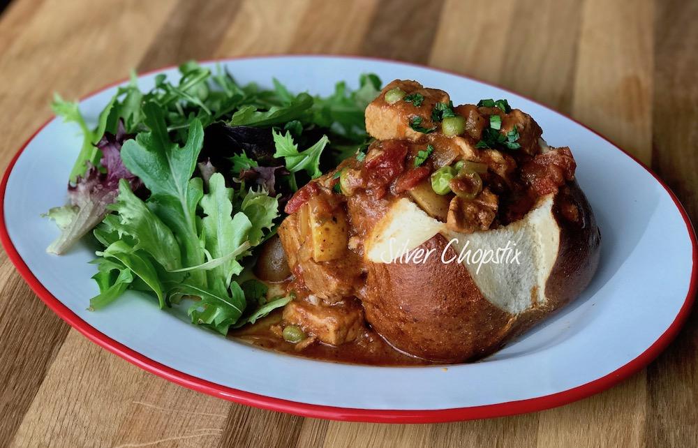 Pork Sarciado in a Pretzel Bread Bowl